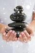 Zdjęcia na płótnie, fototapety, obrazy : Therapist holding pile of stones for massage