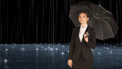 Businesswoman holding umbrella