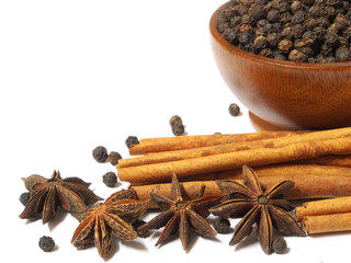 Spices Cloves, Cinnamon sticks and anise stars isolated on white