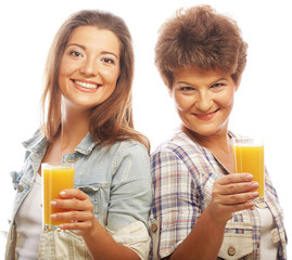 Two women with orange juice.