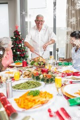 Cheerful family at dining table for christmas