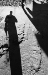 Shadow man returning home lonely