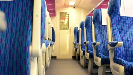 train - interior - seats - first class - door in the background