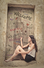beautiful woman who is writing on a door