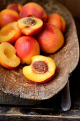 nectarines in an old wooden bucket