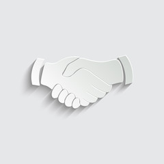 handshake icon with shadow on a grey background