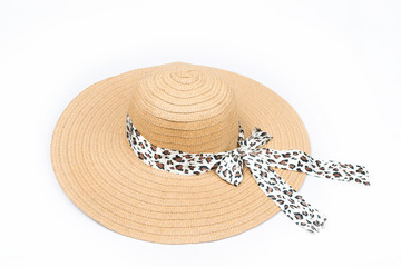 Feminine women's straw hat with the ribbon on white background