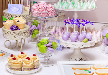 Sweet holiday buffet with cupcakes and meringues