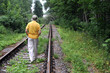 Walking Away Down Railroad Track