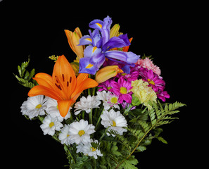 bouquet of iris flowers,lilium and daisies.