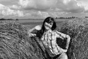 Yoing woman in haystack