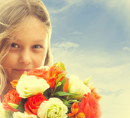 portrait of a beautiful little girl with a bouquet of flowers on