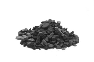 a handful of crushed charcoal on white background