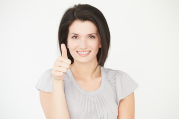 Studio Portrait Of Woman Making Thumbs Up Gesture