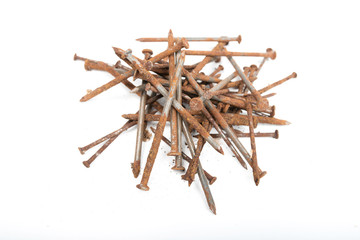 Old rusty pile of iron nails isolated on white background.