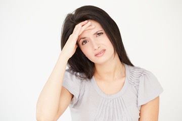 Studio Portrait Of Stressed Woman Against White Background