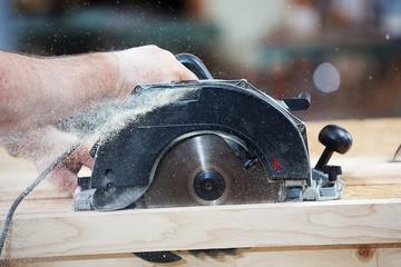 Carpenter with Circular Hand Saw