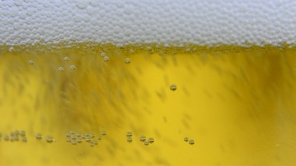Extreme close up of beer poured into glass