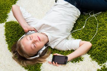 Happy child listening to music.