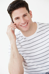 Studio Shot Of Man Using Mobile Phone