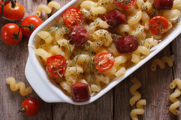 pasta baked with tomatoes, sausages and ingredients top view.