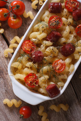 pasta with tomatoes, sausages  Vertical top view