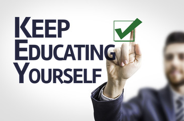 Business man pointing the text: Keep Educating Yourself