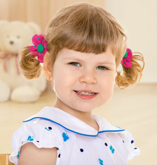 Portrait of cheerful girl with pigtails.