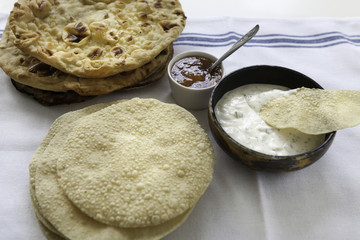 Indian flat breads served vith raita and mango chutney