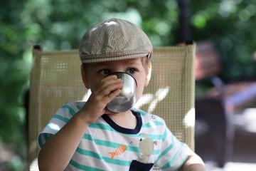 Boy drinks tea