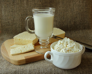 Cottage cheese, feta cheese and a glass of milk.