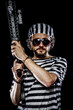 Torture .Prison riot concept. Man holding a machine gun, prisone