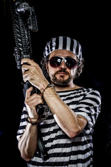 Security.Prison riot concept. Man holding a machine gun, prisone