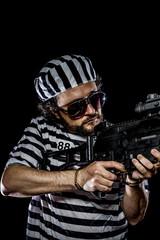 Attack .Prison riot concept. Man holding a machine gun, prisoner