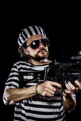 Force .Prison riot concept. Man holding a machine gun, prisoner