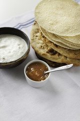 Indian flat breads served with raita andmango chutney