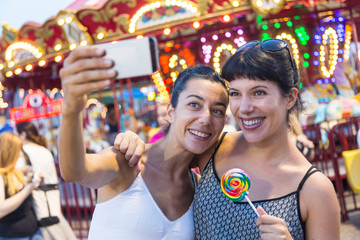 Happy Young Women Taking Selfie at Luna Park