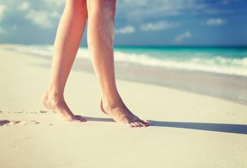 closeup of woman legs on sea shore