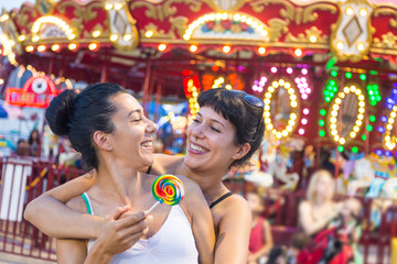Happy Young Women at Luna Park