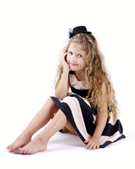 Pretty little girl with long curly hair