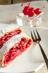 Cherry strudel on the square plate