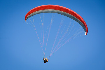 Paraglider in a blue sky