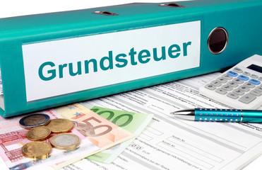 Grundsteuer Ordner mit Geld und Taschenrechner, türkis