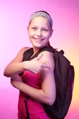 Teen girl goes to school with a backpack on her back