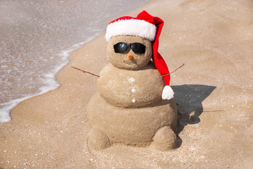 Snowman made out of sand. Holiday concept