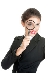 Businesswoman with magnifier