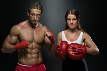 Man Instructor And Woman Training Mixed Martial Art