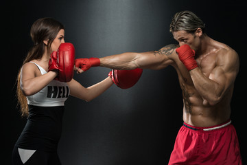 A Young Couple Boxing For Fitness