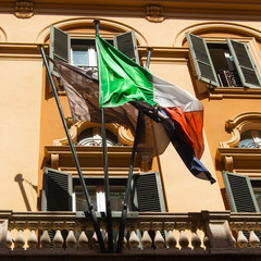 Vintage retro looking Italian flag on a old balcony