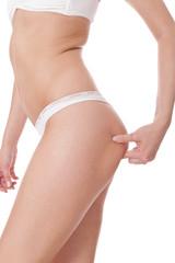 Shapely slender woman posing in lingerie